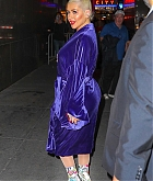 84039118_christina-aguilera-was-seen-wearing-a-purple-robe-as-she-arrived-at-radio-city.jpg