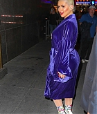 84039122_christina-aguilera-was-seen-wearing-a-purple-robe-as-she-arrived-at-radio-city.jpg