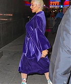 84039124_christina-aguilera-was-seen-wearing-a-purple-robe-as-she-arrived-at-radio-city.jpg