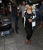 Christina_Aguilera_-_At_LAX_Airport_in_Los_Angeles_on_September_3-11.jpg